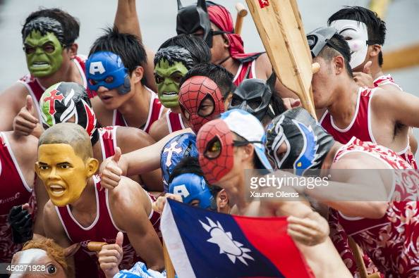 Dragon boat racers pose for photographers during Hong Kong International Dragon Boat Races on June 8 2014 in Hong Kong Hong Kong The dragon boat...