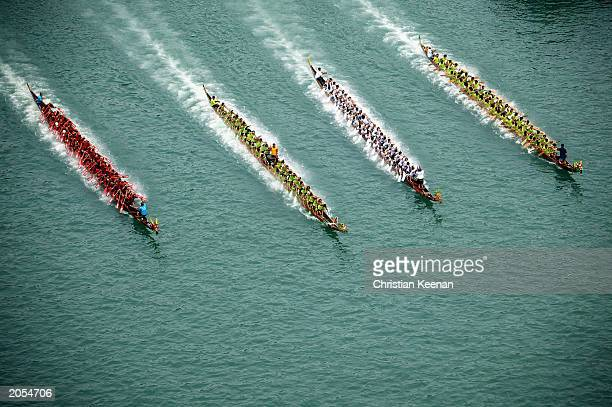Dragon Boat teams participate in a race at Hong Kong's Aberdeen Harbour on June 4 2003 in Hong Kong Dragon boats compete against each other every...
