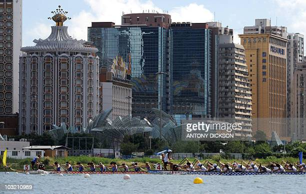 Dragon boats compete against a backdrop of casinos during the Macau Club Crew World Championships dragon boat competition in Macau on August 1 2010...