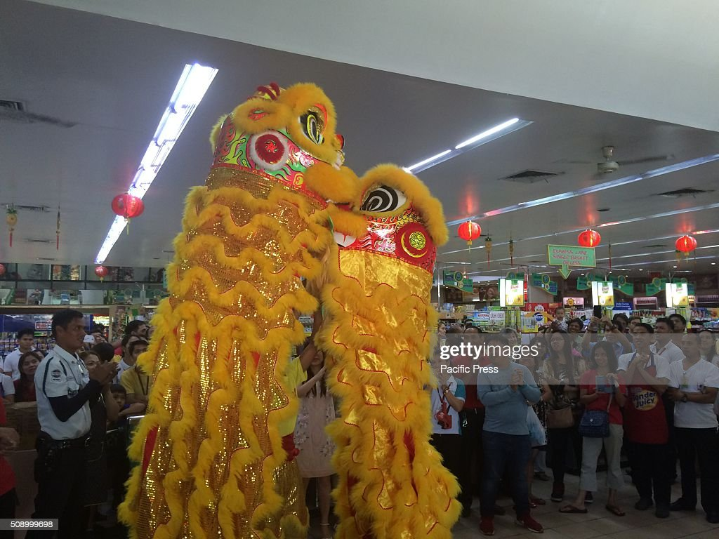 Dragon dance being performed on different establishments in Quezon City during the Chinese New Year celebration. The dragon dance is often performed during Chinese New Year and believed to bring good luck to people, therefore the longer the dragon in the dance, the more luck it will bring to the community.