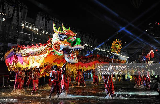 Dragon dance performers make their way down a specially constructed 360 metre waterway during the annual Chinese New Year Chingay parade to mark the...