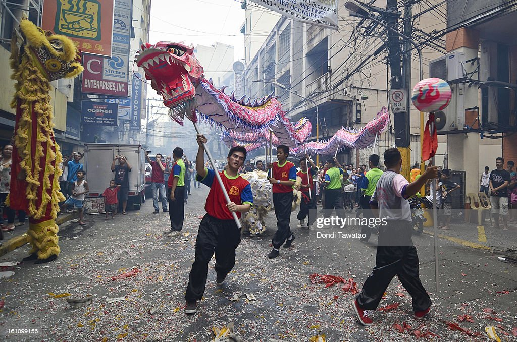 A dragon dance presentation is performed as Chinese Filipinos celebrate the Chinese New Year in the district of Binondo on February 9, 2013 in Manila, Philippines. The Chinese New Year begins tomorrow and this year is the year of the snake, known by locals as 'Spring Festival' or 'Lunar New Year' it is celebrated annually by Chinese Filipinos who make up roughly 20 percent of the local population.