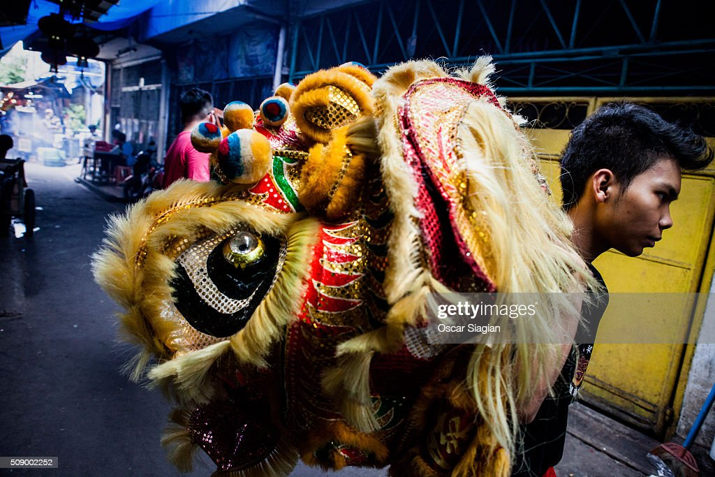 Dragon dancer walk trough small road to reach someone who invite them to bless their house in Glodok district on February 8, 2016 in Jakarta, Indonesia. The Chinese Lunar New Year also known as the Spring Festival, which is based on the Lunisolar Chinese calendar, is celebrated from the first day of the first month of the lunar year and ends with Lantern Festival on the fifteenth day.