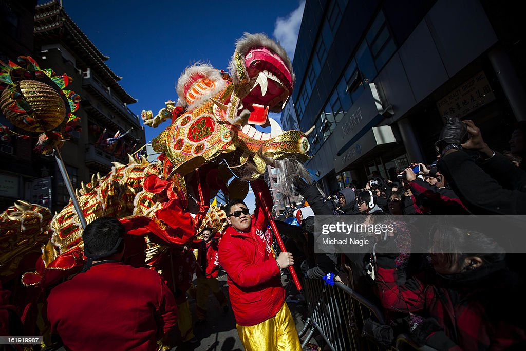 Dragon dancers greet parade-goers during the 14th Annual Chinatown Lunar New Year Parade on February 17, 2013 in New York City. This year celebrates the Year of the Snake.