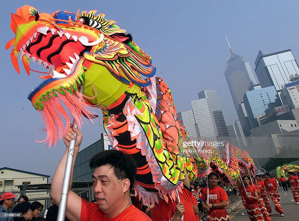 Dragon dancers perform during a Chinese New Year parade in Wanchai district 05 February 2000 Today is the first day of the Chinese New Year of the...