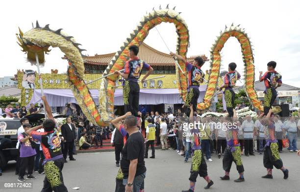 Dragon dancers perform outside a funeral hall during a ceremony for late Taiwanese celebrity Chu Keliang at a local funeral parlor in New Taipei City...