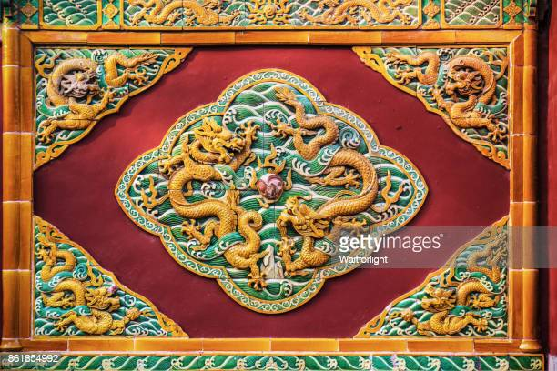 Dragon details on wall in Forbidden city