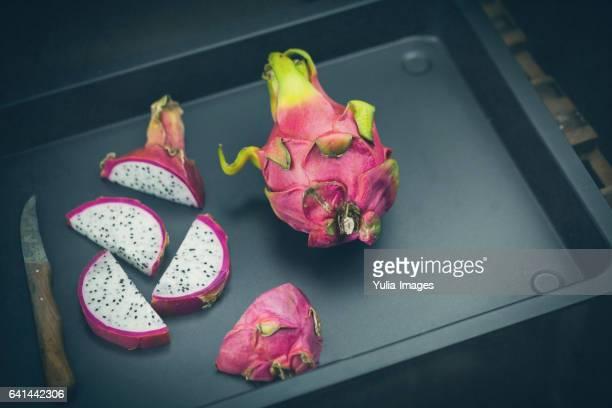 Dragon fruit on dark pan