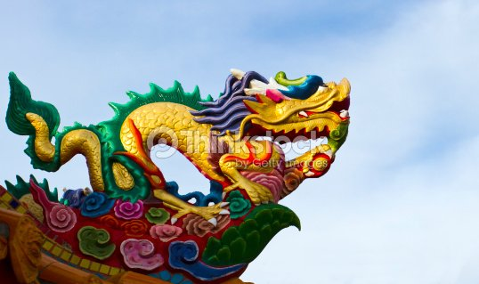 Dragon guard on the roof of Chinese temple : Stock Photo