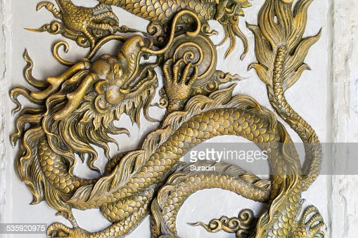 Dragon Sculpture on a wall : Stock Photo
