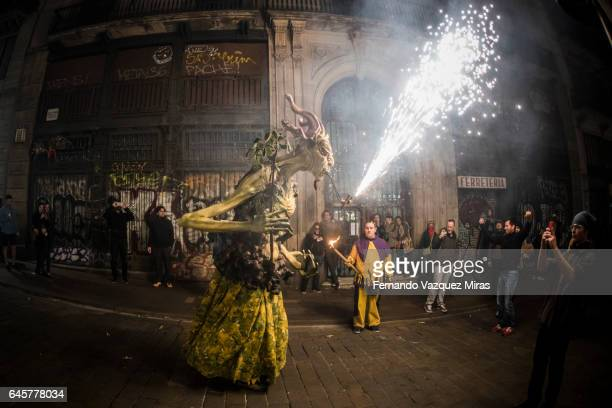 A Dragon toy breathes fire during the traditional festival of 'Correfoc' in Barcelona, Spain