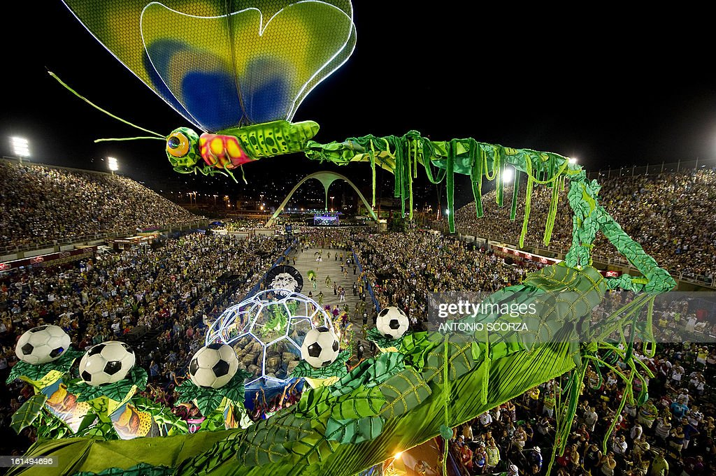 A dragonfly statue, part of Mangueira samba school float, is seen before crashing against a television tower, during their performance on the second night of Carnival parade at the Sambadrome in Rio de Janeiro, Brazil on February 11, 2013.