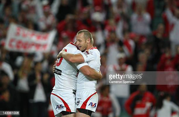 Dragons captain Ben Hornby embraces team mate Michael Weyman after winning the round eight NRL match between the St George Illawarra Dragons and the...