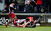 Dragons player Hallam Amos is stopped just short of the try line by Sam Beard of Edinburgh during the Guinness Pro 12 match between Newport Gwent...
