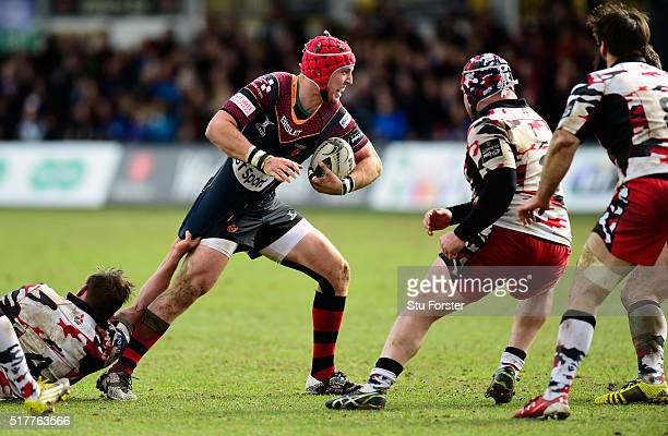 Dragons player Tyler Morgan makes a break during the Guinness Pro 12 match between Newport Gwent Dragons and Edinburgh Rugby at Rodney Parade on...