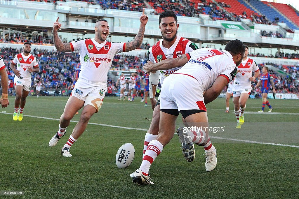 Dragons players celebrate a try during the round 16 NRL match between the Newcastle Knights and the St George Illawarra Dragons at Hunter Stadium on...