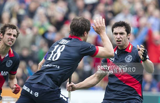 KHC Dragons players Florent van Aubel Jeffrey Thys and Loick Luypaert celebrate a goal during the semi final between German RotWeiss Koln and Belgian...