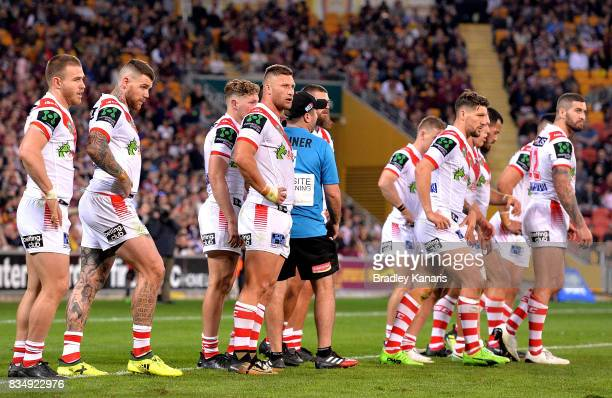 Dragons players look dejected during the round 24 NRL match between the Brisbane Broncos and the St George Illawarra Dragons at Suncorp Stadium on...