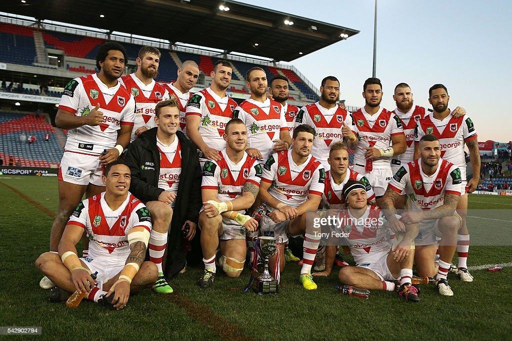 Dragons players pose with the Alex McKinnon Cup during the round 16 NRL match between the Newcastle Knights and the St George Illawarra Dragons at Hunter Stadium on June 25, 2016 in Newcastle, Australia.