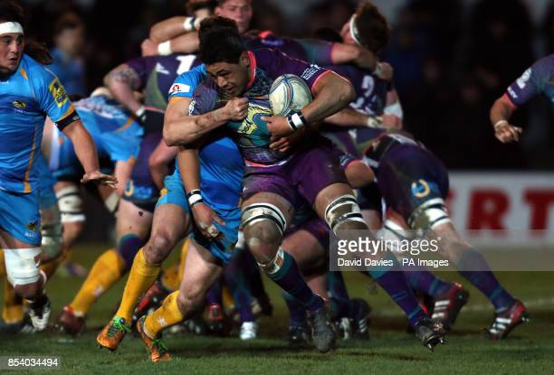 Dragons Toby Faletau is tackled by Charlie Davies of Wasps during the Amlin Challenge Cup at Rodney Parade Newport