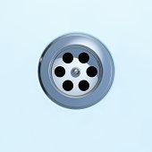 Drain of a bathtub or a sink closeup
