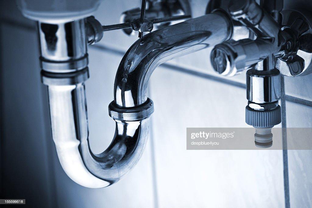Drain pipe under wash basin : Stock Photo
