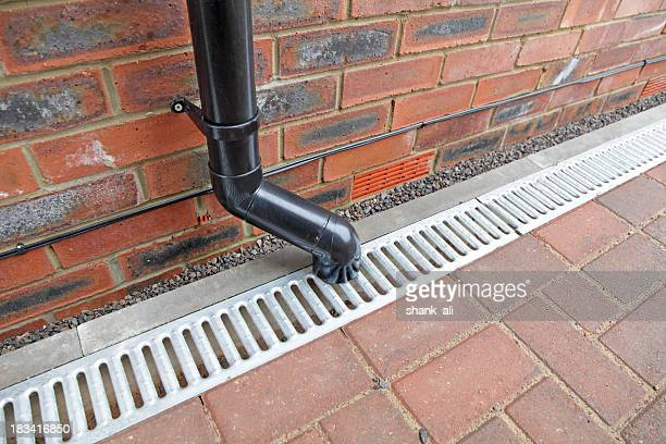 Drain stock photos and pictures getty images for Gutter drainage systems design