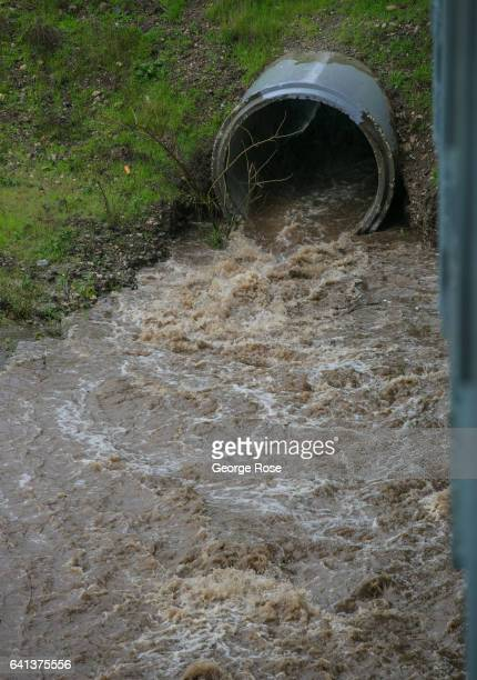 Drains flowing into the Santa Ynez River are filled with rushing water as yet another in a series of storms passes over the Central Coast of...