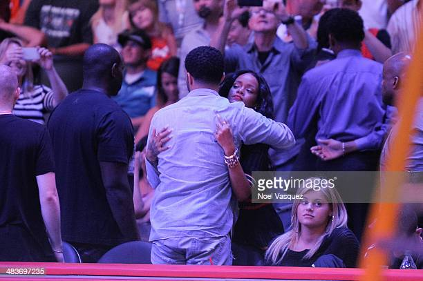 Drake and Rihanna hug during intermission at a basketball game between the Oklahoma City Thunder and the Los Angeles Clippers at Staples Center on...