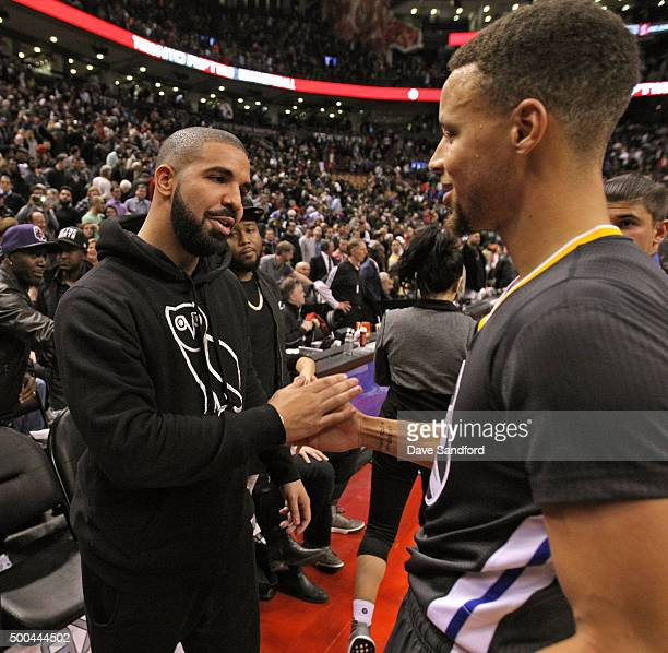 Drake and Stephen Curry of the Golden State Warriors after the game against the Toronto Raptors on December 5 2015 at Air Canada Centre in Toronto...