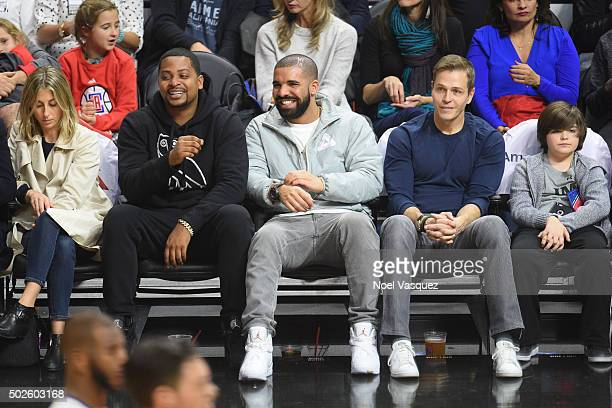 Drake attends a basketball game between the Oklahoma City Thunder and the Los Angeles Clippers at Staples Center on December 21 2015 in Los Angeles...