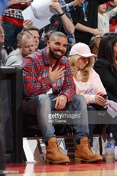 Drake attends the game between the Toronto Raptors and the Cleveland Cavaliers on November 25 2015 at the Air Canada Centre in Toronto Ontario Canada...