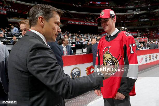 Drake Batherson meets with coach Guy Boucher after being selected 121st overall by the Ottawa Senators during the 2017 NHL Draft at the United Center...
