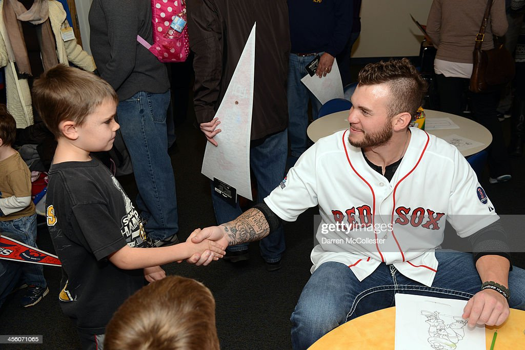 Drake Britton of the Boston Red Sox visits with Brendan at Boston Children's Hospital on December 13, 2013 in Boston, Massachusetts.