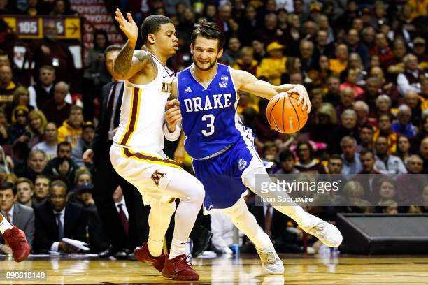 Drake Bulldogs guard Graham Woodward drives towards the net while Minnesota Golden Gophers guard Nate Mason defends during the regular season game...