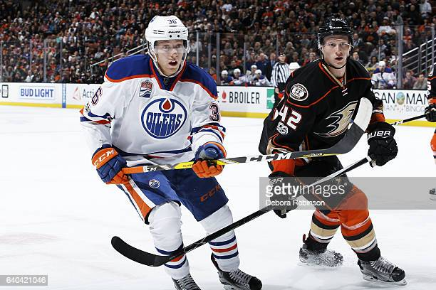 Drake Caggiula of the Edmonton Oilers battles for position against Josh Manson of the Anaheim Ducks during the game on January 25 2017 at Honda...