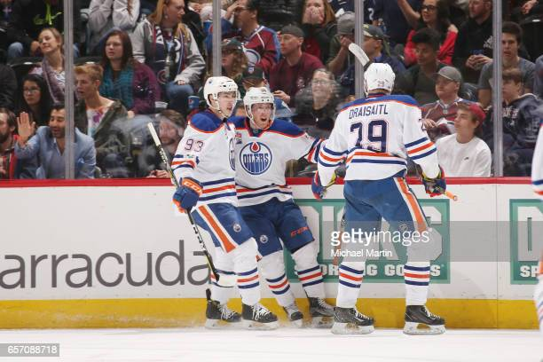Drake Caggiula of the Edmonton Oilers celebrates a go ahead goal against the Colorado Avalanche with teammates Ryan NugentHopkins and Leon Draisaitl...