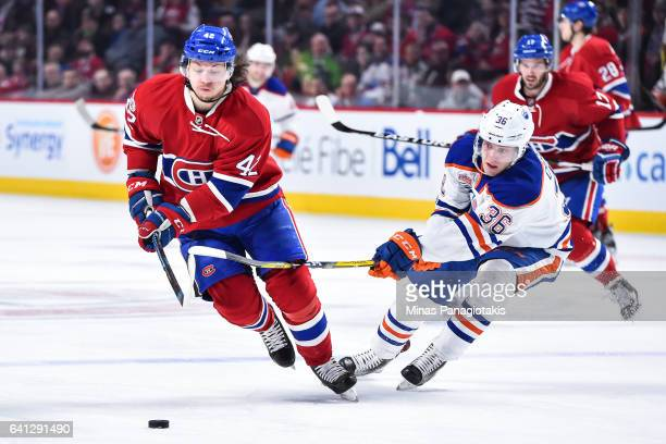 Drake Caggiula of the Edmonton Oilers challenges Sven Andrighetto of the Montreal Canadiens during the NHL game at the Bell Centre on February 5 2017...