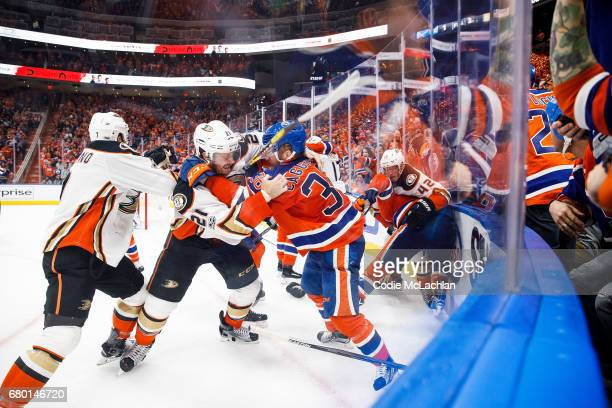 Drake Caggiula of the Edmonton Oilers drops the gloves with Chris Wagner of the Anaheim Ducks in Game Six of the Western Conference Second Round...