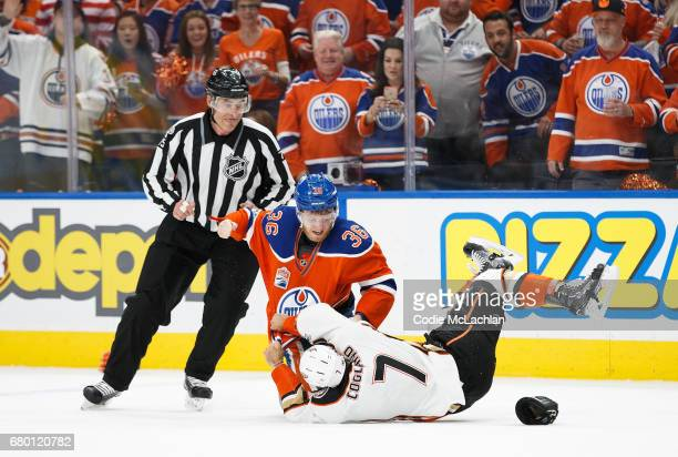 Drake Caggiula of the Edmonton Oilers fights Andrew Cogliano of the Anaheim Ducks in Game Six of the Western Conference Second Round during the 2017...