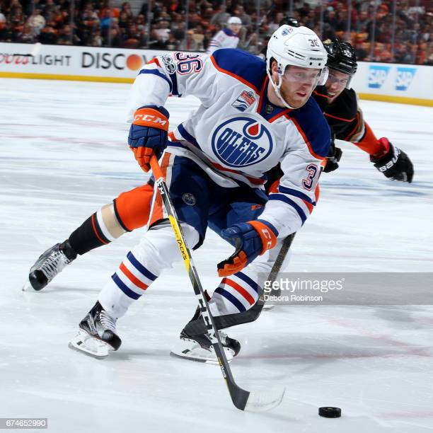 Drake Caggiula of the Edmonton Oilers handles the puck against Shea Theodore of the Anaheim Ducks in Game Two of the Western Conference Second Round...