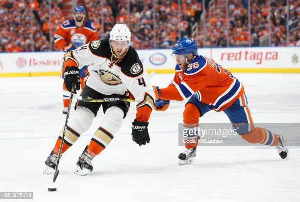 Drake Caggiula of the Edmonton Oilers pursues Cam Fowler of the Anaheim Ducks in Game Six of the Western Conference Second Round during the 2017 NHL...
