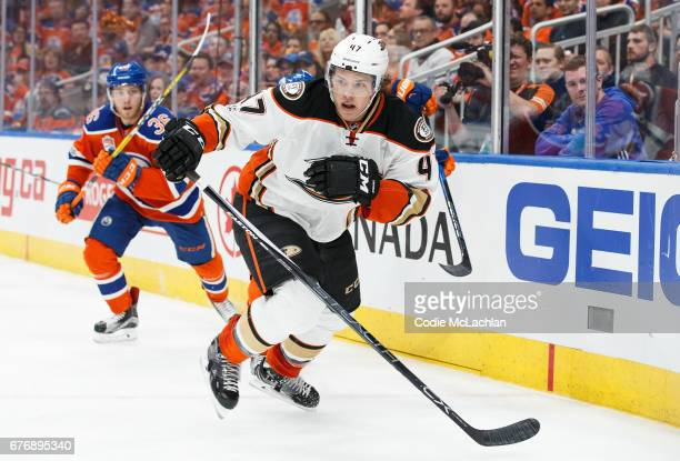 Drake Caggiula of the Edmonton Oilers pursues Hampus Lindholm of the Anaheim Ducks in Game Three of the Western Conference Second Round during the...