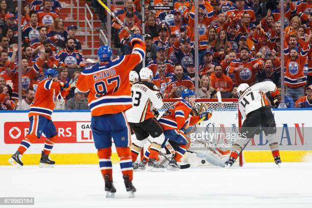 Drake Caggiula of the Edmonton Oilers scores on goalie John Gibson of the Anaheim Ducks in Game Four of the Western Conference Second Round during...