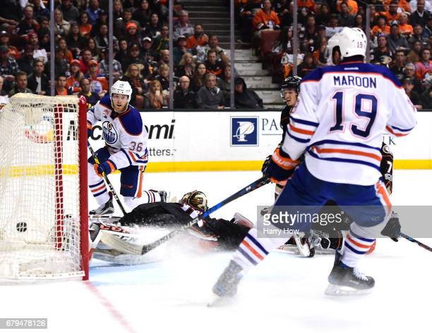 Drake Caggiula of the Edmonton Oilers scores on John Gibson of the Anaheim Ducks to take a 30 lead as Patrick Maroon looks on during the second...