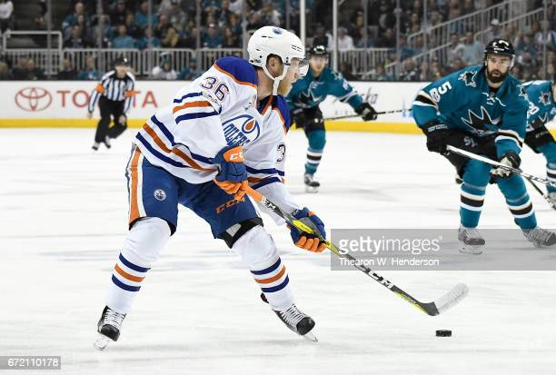 Drake Caggiula of the Edmonton Oilers skates with control of the puck against the San Jose Sharks during the first period in Game Four of the Western...