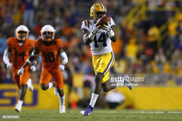 Drake Davis of the LSU Tigers catches the ball for a touchdown during the second half of a game against the Syracuse Orange at Tiger Stadium on...