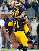 Drake Johnson of the Michigan Wolverines celebrates a touchdown with Ben Branden during the Michigan Football Spring Game on April 1 2016 at Michigan...
