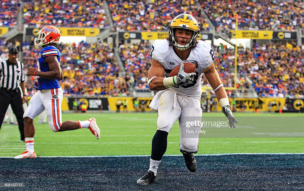 Drake Johnson #20 of the Michigan Wolverines scores a touchdown during the second half of the Buffalo Wild Wings Citrus Bowl game against the Florida Gators at Orlando Citrus Bowl on January 1, 2016 in Orlando, Florida.