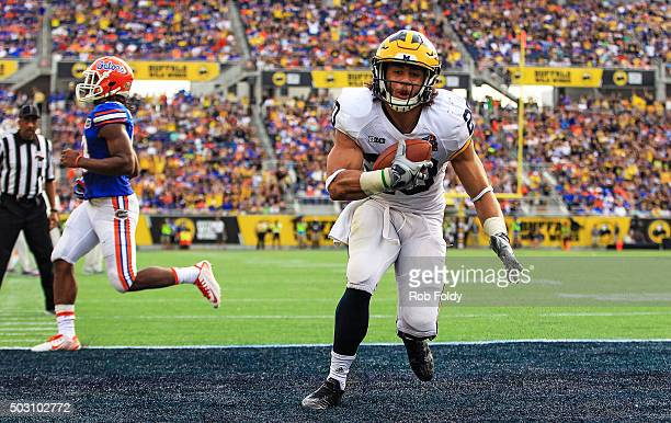 Drake Johnson of the Michigan Wolverines scores a touchdown during the second half of the Buffalo Wild Wings Citrus Bowl game against the Florida...